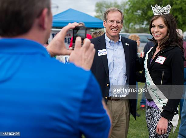 Candidate for US Senate Rep Jack Kingston RGa poses for a photo with 2014 Miss Georgia Sweet Onion Sarah DeLoach at the Law Enforcement Cookout at...