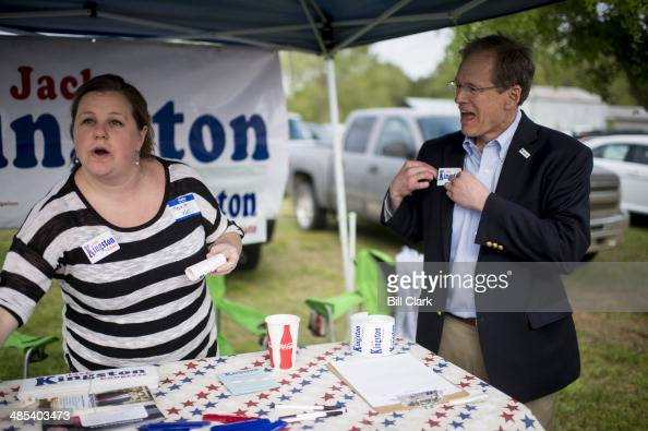 Candidate for US Senate Rep Jack Kingston RGa puts on one of his campaign stickers as he arrives at the Law Enforcement Cookout at Wayne Dasher's...
