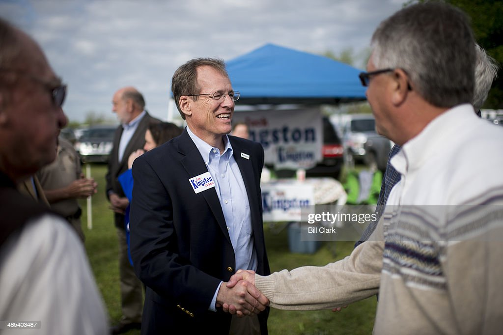 Candidate for US Senate Rep Jack Kingston RGa speaks with attendees as he arrives at the Law Enforcement Cookout at Wayne Dasher's pond house in...