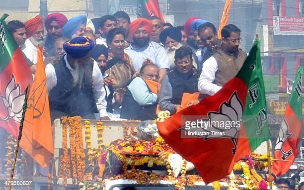 BJP candidate from Amritsar Arun Jaitley trying to save his face from the flames that erupted after the explosion during road show on March 18 2014...