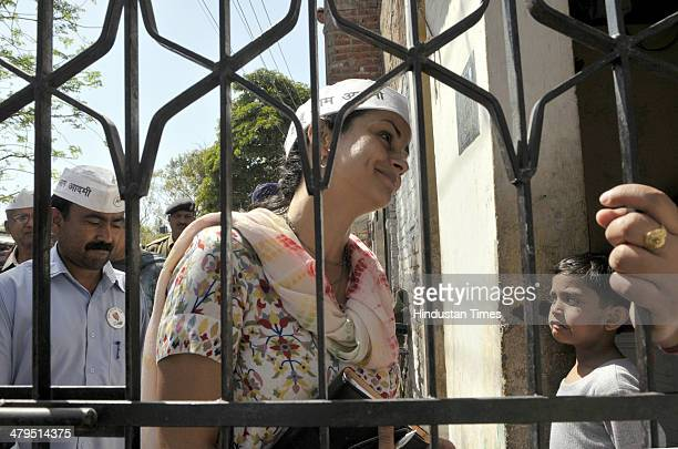 AAP candidate from Chandigarh and Bollywood actor Gul Panag meeting with people during door to door campaigning at Maloya area near sector 39 on...