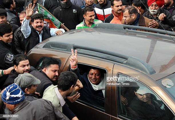 BJP candidate from Jammu East Rajesh Gupta gestures after his win outside their party headquarters on December 23 2014 in Jammu India PDP emerged as...