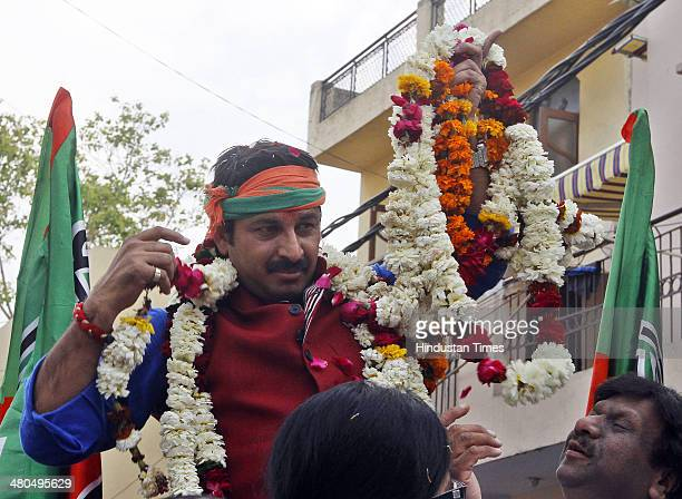 BJP candidate from Northeast Delhi Lok Sabha constituency Manoj Tiwari during an election campaign at Rohtas Nagar Shahdra on March 25 2014 in New...
