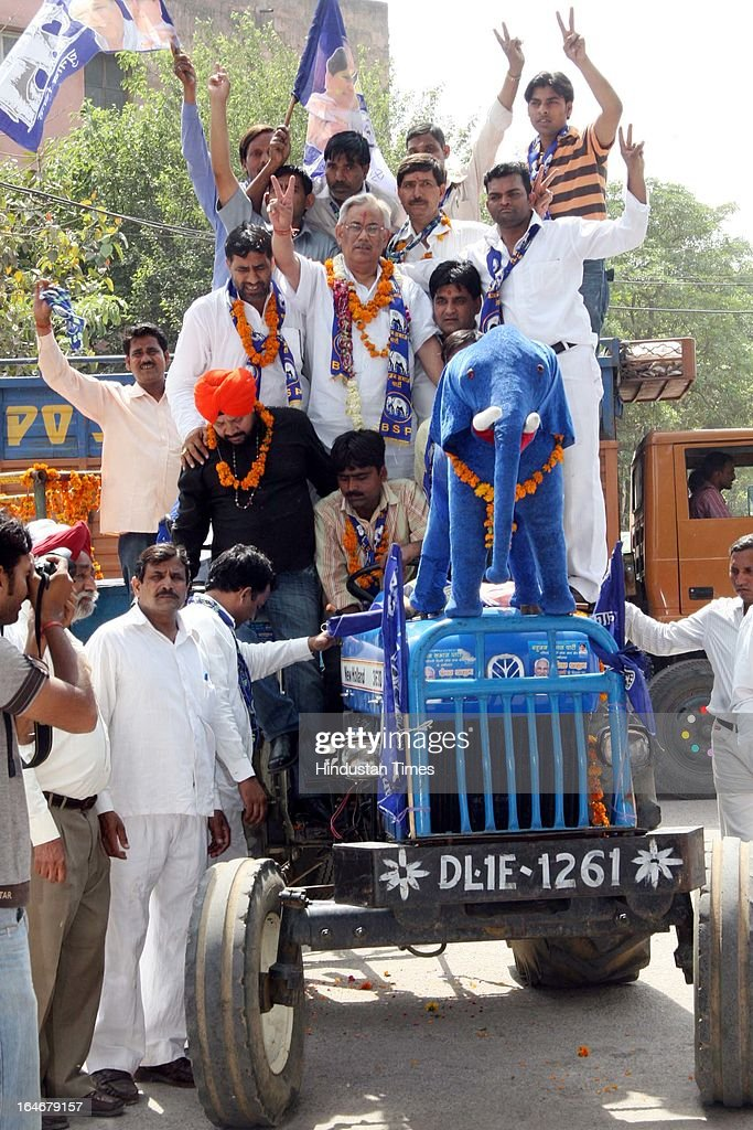 BSP Candidate from West Delhi Deepak Bhardwaj and his supporters going to file his nomination on tractor at Rampura on April 16, 2009 in New Delhi, India. Deepak Bhardwaj, a real estate developer and a local BSP leader was shot dead by two men in his south Delhi farmhouse after an altercation on March 26, 2013.