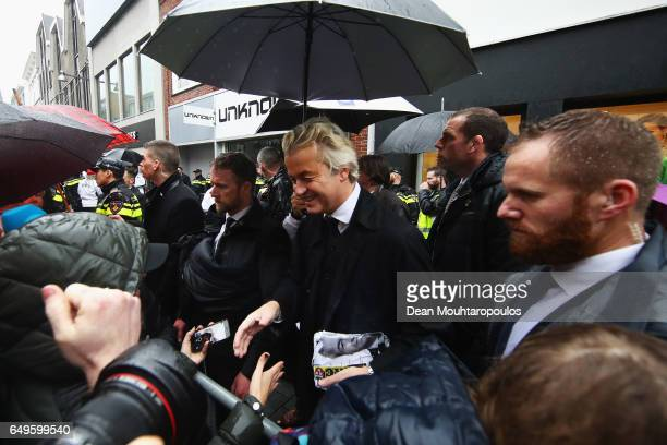 Candidate Geert Wilders is guarded by police as he speaks to the crowd hands out pamphlets or flyers and poses for selfies on his election campaign...