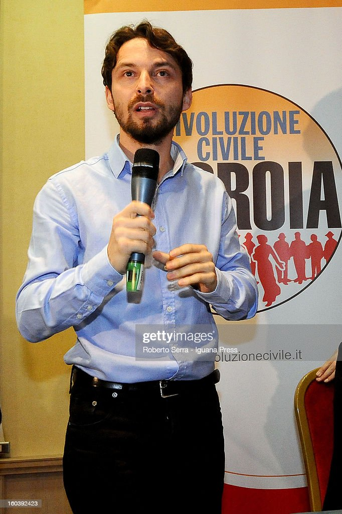 Candidate Giovanni Favia with Rivoluzione Civile party in the forthcoming Italian Parliamentary elections in Febraury attends a meeting with candidate Premier Antonio Ingroia at Hotel Europa on January 30, 2013 in Bologna, Italy.