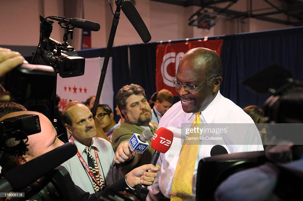 Candidate Herman Cain speaks in the spin room following the Republican presidential primary debate June 13, 2011 at Saint Anselm College in Manchester, New Hampshire. Tonight's debate was the first for the 2012 GOP contenders in the 'First in the Nation' primary state of New Hampshire.