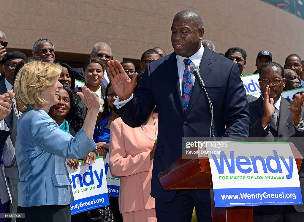 Candidate in the Los Angeles city mayoral race, City Controller Wendy Greuel (L) gets high five from NBA legend and busiessman Earvin 'Magic' Johnson after getting his endorsement for the Los Angeles mayoral race during a news conference at the West Angeles Church of God on March 28, 2013 in Los Angeles, California. Garcetti is in a tight race for the May 21 runoff against second-place finisher City Controller Wendy Greuel.