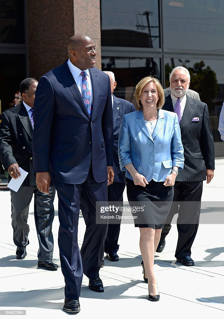 Candidate in the Los Angeles city mayoral race, City Controller Wendy Greuel (R) arrives with NBA legend and busiessman Earvin 'Magic' Johnson to news conference where he endorsed Greuel for the Los Angeles mayoral race at the West Angeles Church of God on March 28, 2013 in Los Angeles, California. Garcetti is in a tight race for the May 21 runoff against second-place finisher City Controller Wendy Greuel.