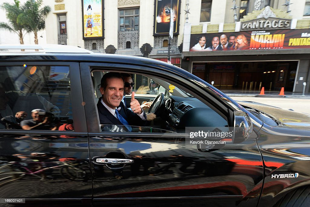 Candidate in the Los Angeles City mayoral race, Councilman Eric Garcetti flashs a thumbs up as he drives away after meeting supporters at a Metro trains station on Hollywood Boulevard on May 21, 2013 in the Silver Lake area of Los Angeles, California. In what could be a record-low voter turnout, Garcetti is up against Los Angeles City Controller Wendy Greuel for the seat held by two-term Antonio Villaraigosa.