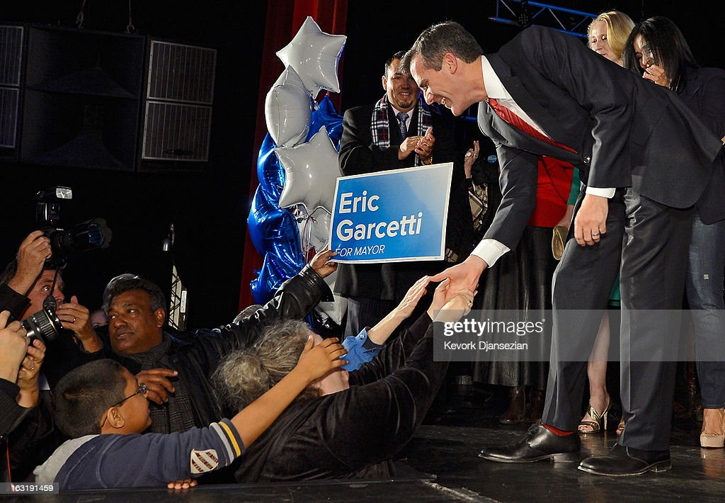 Candidate in the Los Angeles City mayoral race, Councilman Eric Garcetti shakes supporters' hands at an election night party on March 5, 2013 in Los Angeles, California. Garcetti and Los Angeles City Controller Wendy Greuel are locked in a close tie for the lead in the Los Angeles mayoral primary. The top two vote getters will face each other in a run-off election in May.
