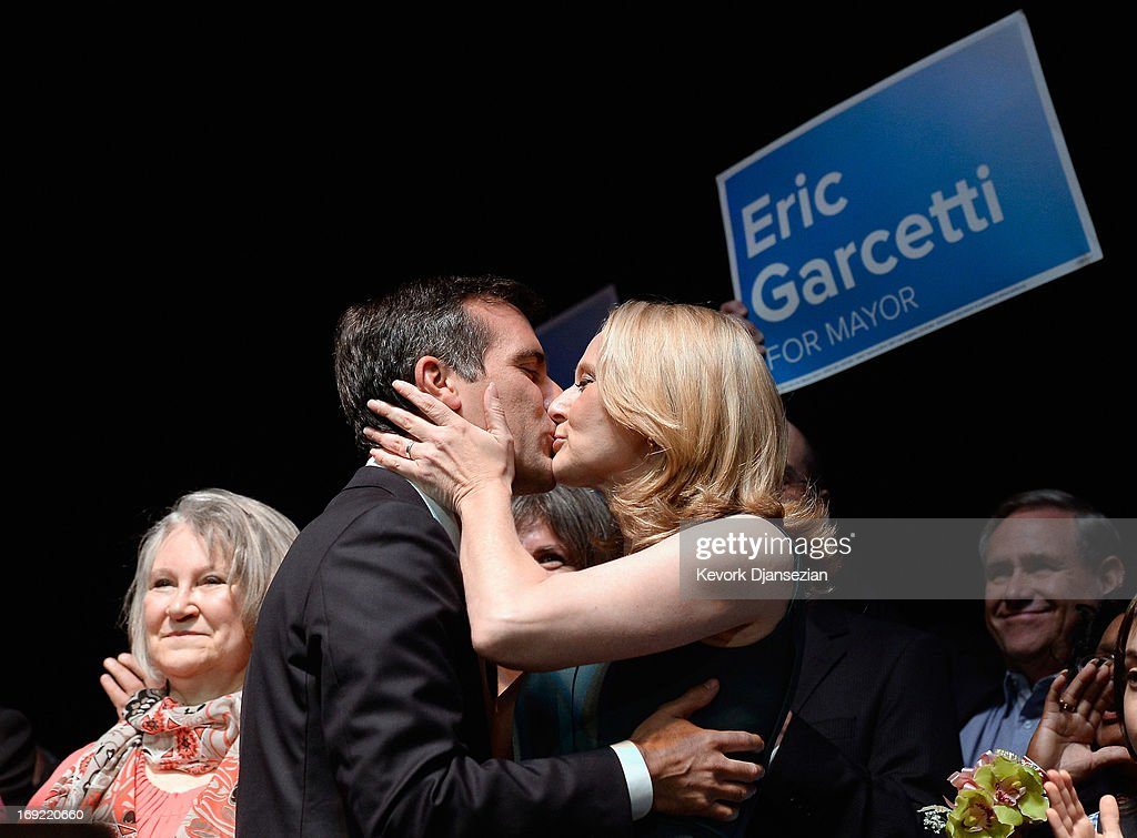 Candidate in the Los Angeles City mayoral race, Councilman <a gi-track='captionPersonalityLinkClicked' href=/galleries/search?phrase=Eric+Garcetti&family=editorial&specificpeople=635706 ng-click='$event.stopPropagation()'>Eric Garcetti</a> gets a kiss from his wife Amy Wakeland as they celebrate with supporters at an election night party at The Hollywood Palladium on May 21, 2013 in the Silver Lake area of Los Angeles, California. Early results suggest that Garcetti is leading against Los Angeles City Controller Wendy Greuel for the seat held by two-term Antonio Villaraigosa.