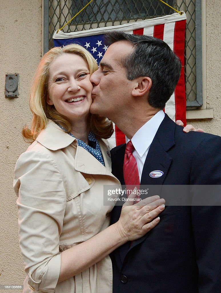 Candidate in the Los Angeles City mayoral race, Councilman Eric Garcetti kisses his wife Amy Wakeland after they voted at Allesandro Elementary School on March 5, 2013 in the Silver Lake area of Los Angeles, California. Garcetti and Los Angeles City Controller Wendy Greuel are locked in a close tie for the lead in the Los Angeles mayoral primary. The top two vote-getters will face each other in a run-off election in May.