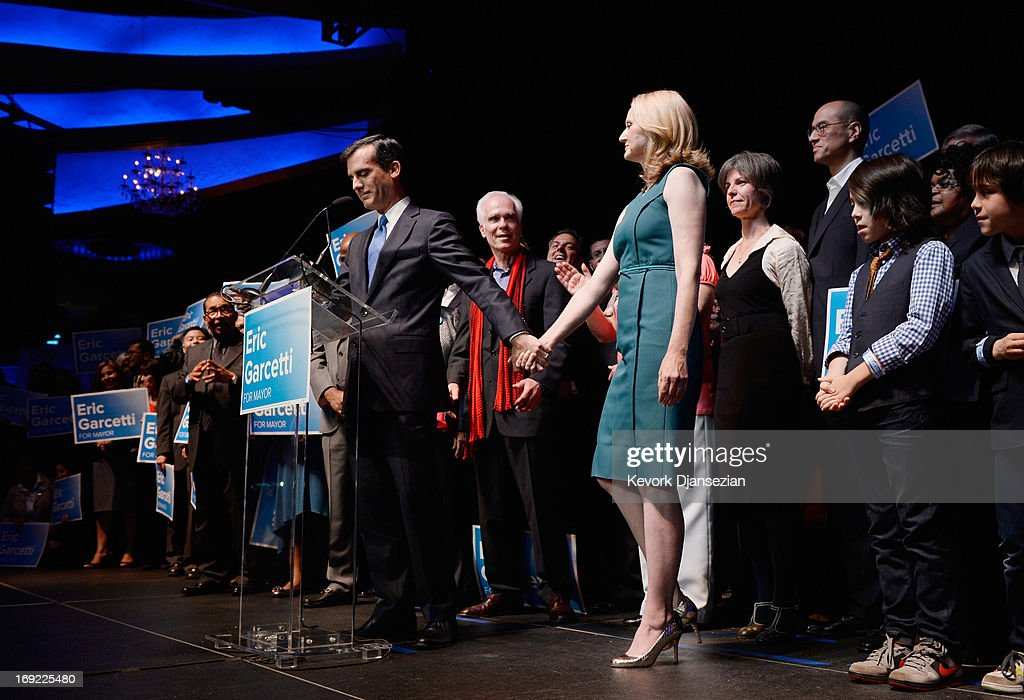 Candidate in the Los Angeles City mayoral race, Councilman Eric Garcetti holds his wife Amy Wakeland as he thanks her during his speech to supporters at an election night party at The Hollywood Palladium on May 21, 2013 in the Silver Lake area of Los Angeles, California. Early results suggest that Garcetti is leading against Los Angeles City Controller Wendy Greuel for the seat held by two-term Antonio Villaraigosa.