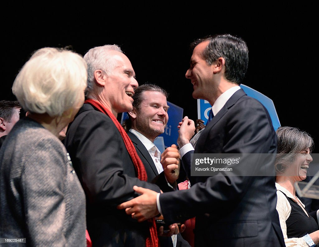 Candidate in the Los Angeles City mayoral race, Councilman Eric Garcetti (R) hugs his father former Los Angeles District Attorney Gil Garcetti as he celebrates with family and supporters at an election night party at The Hollywood Palladium on May 21, 2013 in the Silver Lake area of Los Angeles, California. Early results suggest that Garcetti is leading against Los Angeles City Controller Wendy Greuel for the seat held by two-term Antonio Villaraigosa.