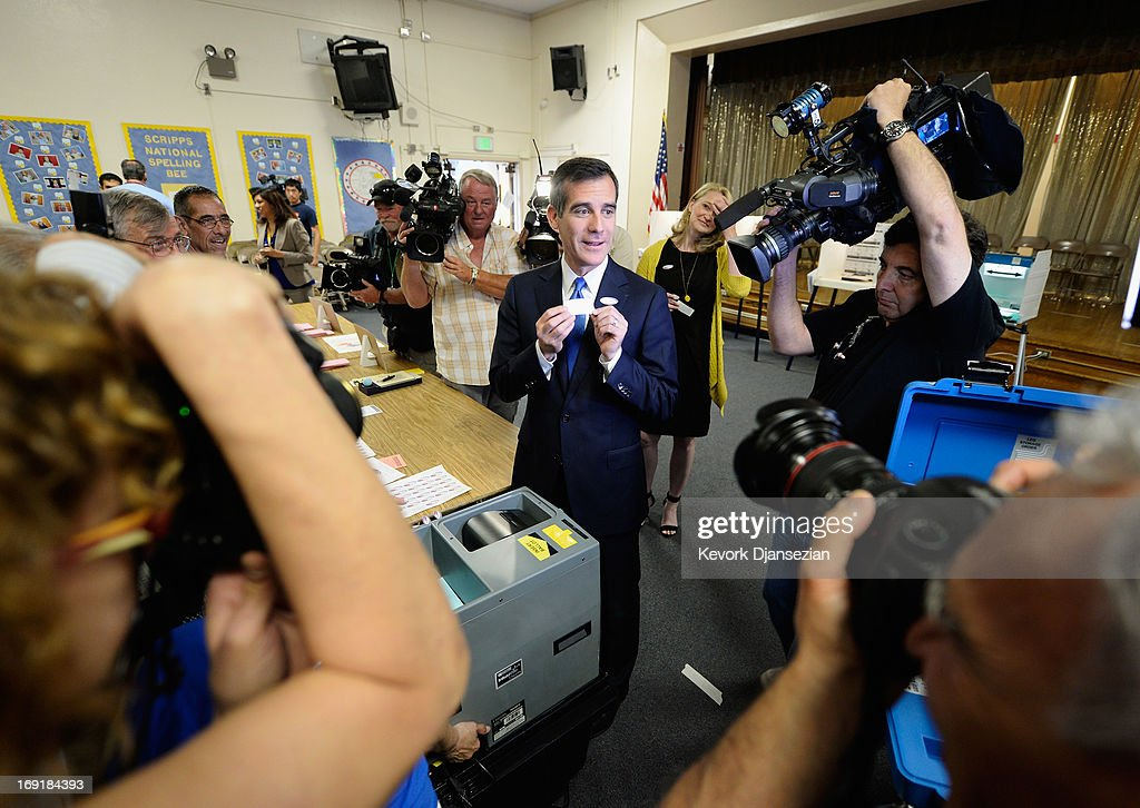 Candidate in the Los Angeles City mayoral race, Councilman <a gi-track='captionPersonalityLinkClicked' href=/galleries/search?phrase=Eric+Garcetti&family=editorial&specificpeople=635706 ng-click='$event.stopPropagation()'>Eric Garcetti</a> shows his ballot stub after voting in the Los Angeles Mayoral run-off race at Allesandro Elementary School on May 21, 2013 in the Silver Lake area of Los Angeles, California. In what could be a record-low voter turnout, Garcetti is up against Los Angeles City Controller Wendy Greuel for the seat held by Antonio Villaraigosa.