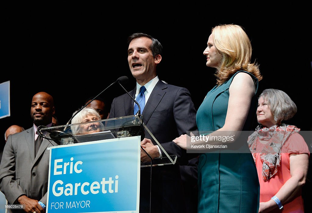 Candidate in the Los Angeles City mayoral race, Councilman Eric Garcetti speaks to supporters with his wife Amy Wakeland at his side at an election night party at The Hollywood Palladium on May 21, 2013 in the Silver Lake area of Los Angeles, California. Early results suggest that Garcetti is leading against Los Angeles City Controller Wendy Greuel for the seat held by two-term Antonio Villaraigosa.