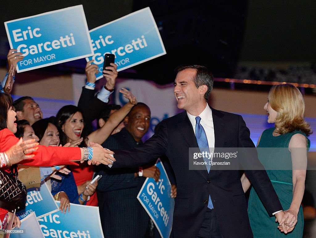 Candidate in the Los Angeles City mayoral race, Councilman Eric Garcetti (R) celebrates with supporters at an election night party at The Hollywood Palladium on May 21, 2013 in the Silver Lake area of Los Angeles, California. Early results suggest that Garcetti is leading against Los Angeles City Controller Wendy Greuel for the seat held by two-term Antonio Villaraigosa.