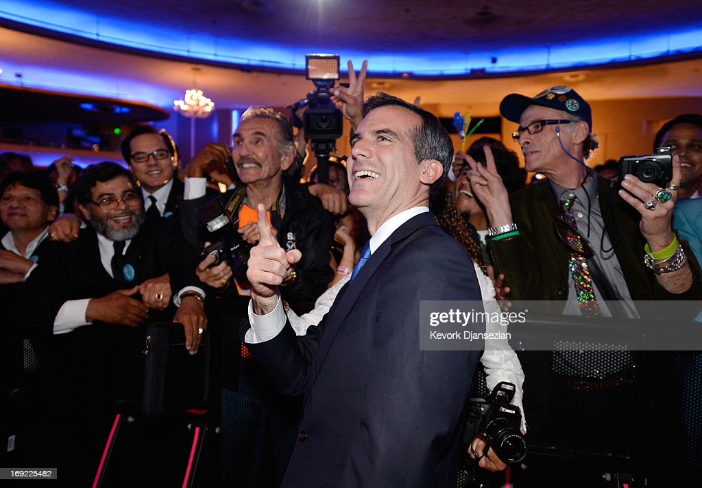 Candidate in the Los Angeles City mayoral race, Councilman <a gi-track='captionPersonalityLinkClicked' href=/galleries/search?phrase=Eric+Garcetti&family=editorial&specificpeople=635706 ng-click='$event.stopPropagation()'>Eric Garcetti</a> celebrates with supporters at an election night party at The Hollywood Palladium on May 21, 2013 in the Silver Lake area of Los Angeles, California. Early results suggest that Garcetti is leading against Los Angeles City Controller Wendy Greuel for the seat held by two-term Antonio Villaraigosa.