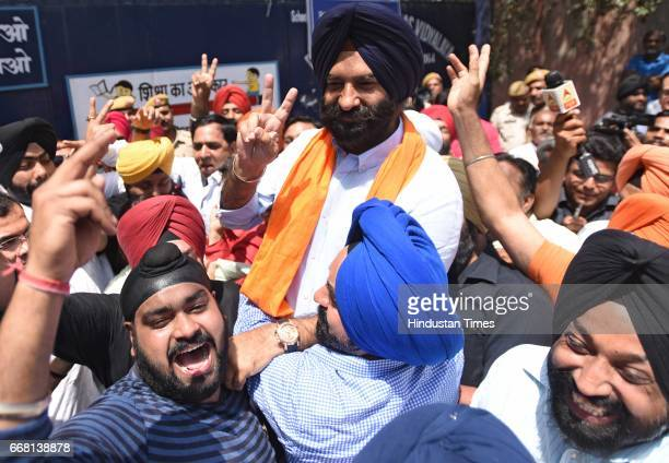 SAD candidate Manjinder Singh Sirsa celebrates the victory with supporters after winning the bypoll on April 13 2017 in New Delhi India BJP...