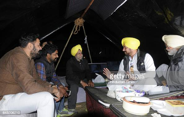Candidate Nabha Gurdev Singh Mann with party worker guard outside a sealed 'strong room' where Electronic Voting Machines at Gov Physical College on...