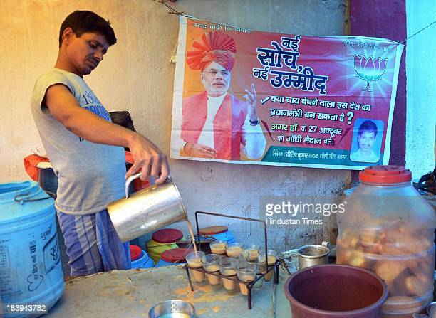 Candidate Narendra Modi's banner at tea stalls on October 10 2013 in Patna India BJP supporters are renaming the existing roadside stalls that sell...