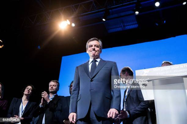 Candidate of Les Republicains right wing Party for the 2017 French Presidential Election Francois Fillon delivers a speech during a Campaign rally on...