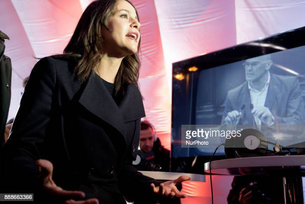 Candidate of the Ciutadans party Ines Arrimadas attends the media close to a TV showing former Catalan Exterior Minister Raul Romeva during a visit...