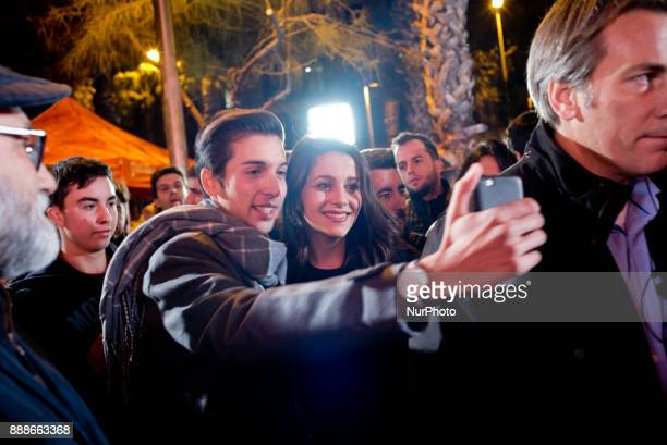 Candidate of the Ciutadans party Ines Arrimadas poses for a selfie with a supporter during a visit to a Ciudadanos election campaign stand on 8...