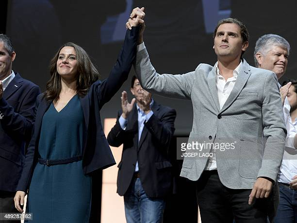 Candidate of the Ciutadans political party Ines Arrimadas and party's leader Albert Ribera hold their hands during a campaign meeting for the...