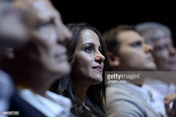 Candidate of the Ciutadans political party Ines Arrimadas sits next to party's leader Albert Ribera during a campaign meeting for the upcoming...