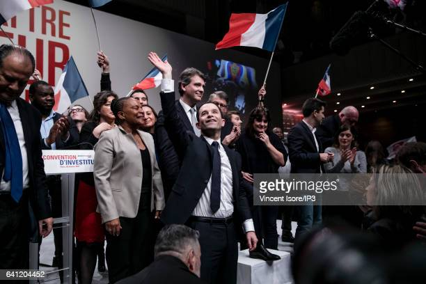Candidate of the Socialist Party for the 2017 French Presidential Election Benoit Hamon is surrounded by his political supporters during his National...
