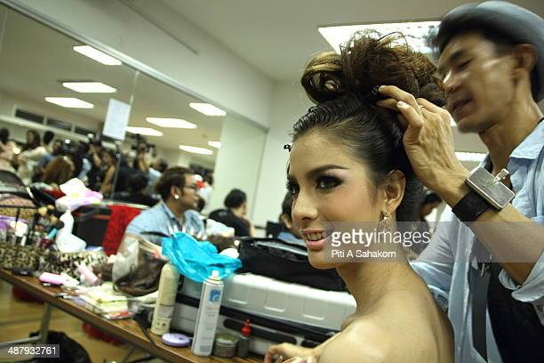 A candidate prepares and makes up backstage of the Miss Tiffany Universe contest 2014 in Pattaya This year marked the 40th anniversary of the...