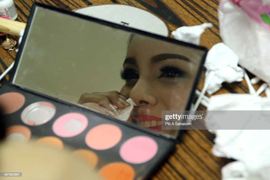 A candidate prepares and makes up backstage of the Miss Tiffany Universe contest 2014 in Pattaya. This year marked the 40th anniversary of the Tiffany's show in Pattaya and this was the 16th Miss Tiffany Universe contest with all of the transsexual or transvestite contestants, aiming to promote human rights for the trans-gender population in Thailand.