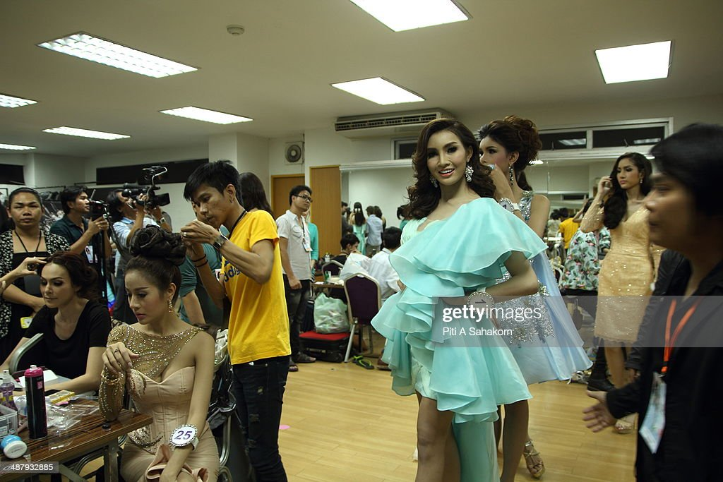 A candidate prepares and poses for a photo backstage for The Miss Tiffany Universe contest 2014 in Pattaya. This year marked the 40th anniversary of the Tiffany's show in Pattaya and this was the 16th Miss Tiffany Universe contest with all of the transsexual or transvestite contestants, aiming to promote human rights for the trans-gender population in Thailand.