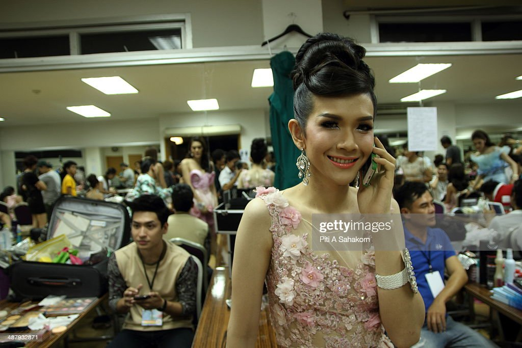 A candidate prepares and poses for a photo backstage of the Miss Tiffany Universe contest 2014 in Pattaya. This year marked the 40th anniversary of the Tiffany's show in Pattaya and this was the 16th Miss Tiffany Universe contest with all of the transsexual or transvestite contestants, aiming to promote human rights for the trans-gender population in Thailand.
