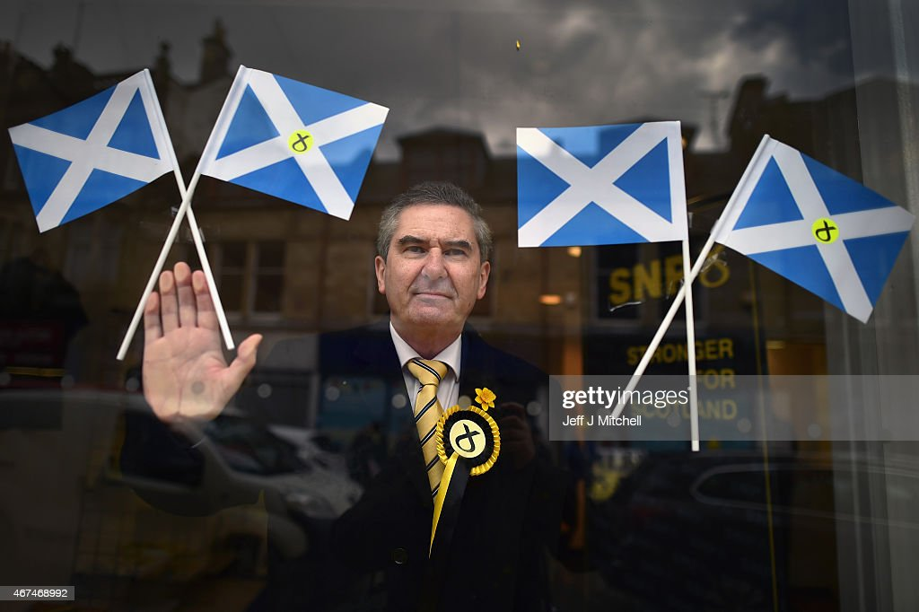 SNP candidate Roger Mullin, opens a general election campaign shop in the constituency of former prime minister <a gi-track='captionPersonalityLinkClicked' href=/galleries/search?phrase=Gordon+Brown&family=editorial&specificpeople=158992 ng-click='$event.stopPropagation()'>Gordon Brown</a> on March 24, 2015 in Kirkcaldy, Scotland. According to a poll from Lord Ashcroft, Labour is set to lose <a gi-track='captionPersonalityLinkClicked' href=/galleries/search?phrase=Gordon+Brown&family=editorial&specificpeople=158992 ng-click='$event.stopPropagation()'>Gordon Brown</a>'s current seat with as much as a 28% swing to the SNP.