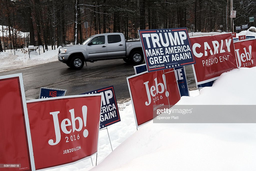 Candidate signs are displayed in front of a middle school serving as a voting station on the day of the New Hampshire Primary on February 9, 2016 in Bow, New Hampshire. After months of campaigning, voters across New Hampshire get to go to the polls today to vote for Democratic and Republican presidential candidates. Following New Hampshire, the race for the presidency moves to South Carolina.