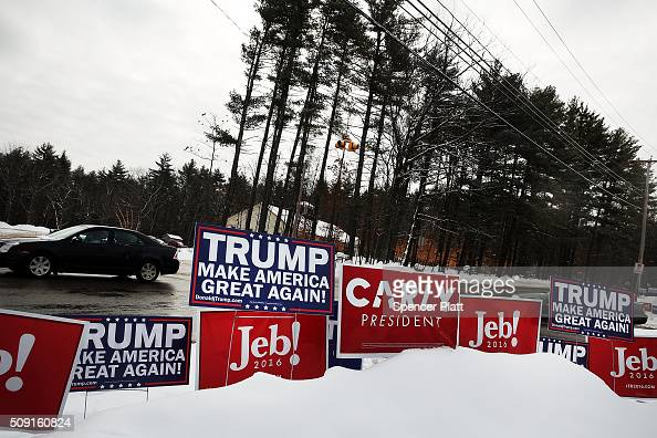 Candidate signs are displayed in front of a middle school serving as a voting station on the day of the New Hampshire Primary on February 9 2016 in...