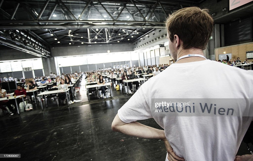 Candidates applying for a place at the Medical University of Vienna sit an exam in a hall of the fair grounds in Vienna on July 5, 2013. According to unofficial data, almost 10,000 people are applying for only 700 places available.