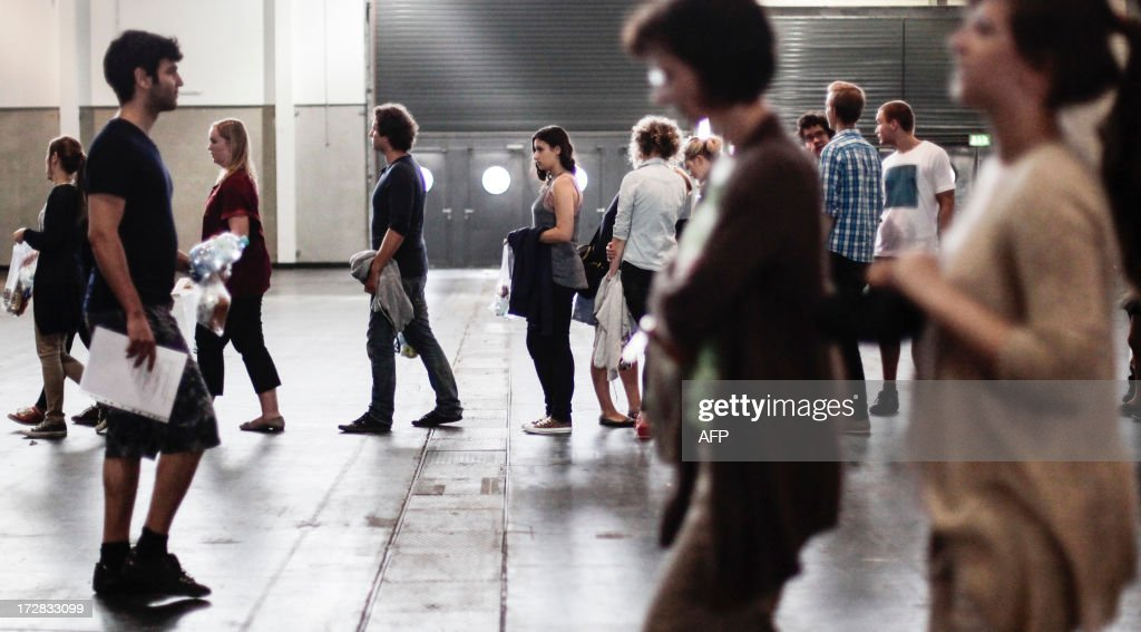 Candidates applying for a place at the Medical University of Vienna line up in a hall of the fair grounds in Vienna to sit an exam on July 5, 2013. According to unofficial data, almost 10,000 people are applying for only 700 places available.