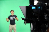 Candidates audition in front of a green screen during the AOL Live Anchor Quest 2013 on June 27 2013 in New York City