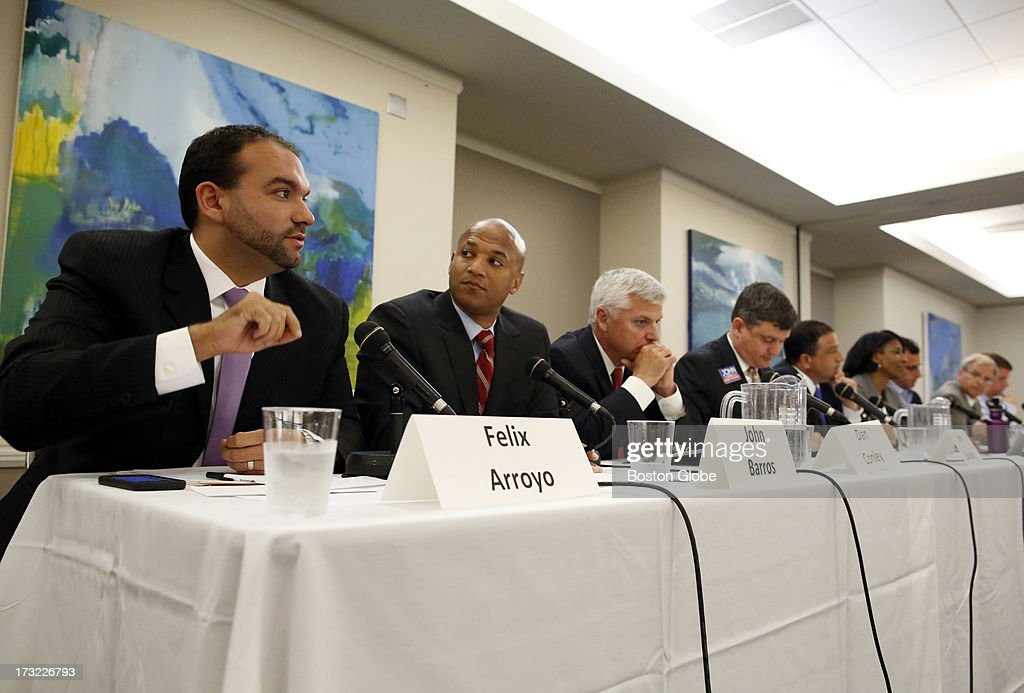 Felix Arroyo, John Barros, Dan Conley, John Connolly, Rob Consalvo, Charlotte Golar Richie, Mike Ross, Bill Walczak and Marty Walsh partake in a Mayoral Forum on 'Energy, The Environment & The Innovation Economy' at Suffolk Law School in Boston, July 9, 2013.