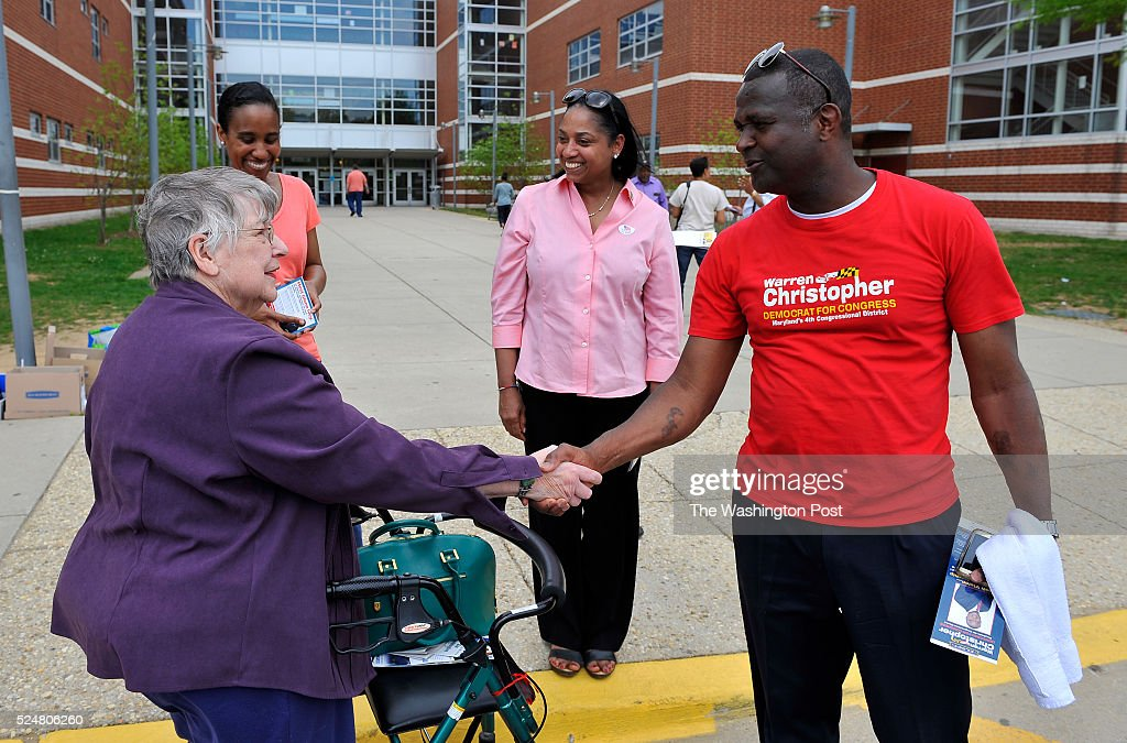 Candidates for the 4th Congressional District Warren Christopher talked with voter as Joseline Pe��a-Melnyk waited to talk to her outside of the Charles Herbert Flowers high school on April 26, 2016 in Springdale, Md.
