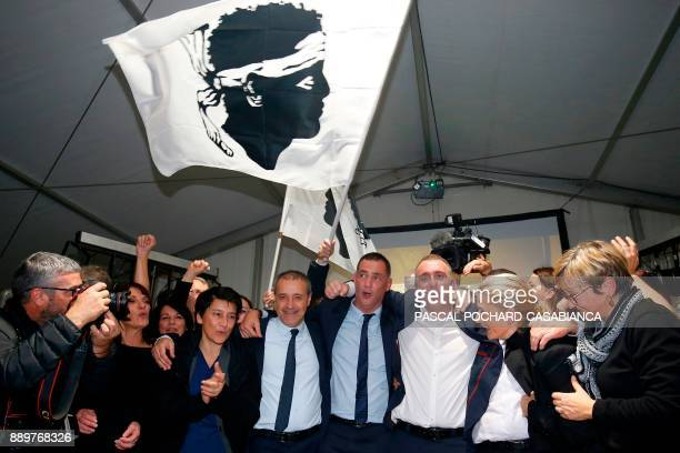 Candidates for the Pe a Corsica nationalist party Jean Guy Talamoni and Gilles Simeoni celebrate with supporters after the annoucement of the results...
