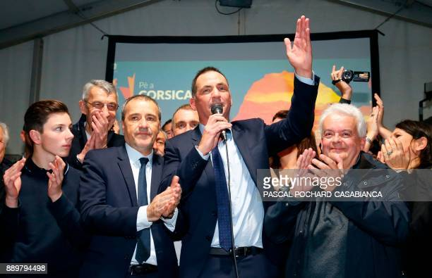 Candidates for the Pe a Corsica nationalist party Jean Guy Talamoni and Gilles Simeoni address party members and supporters after the annoucement of...