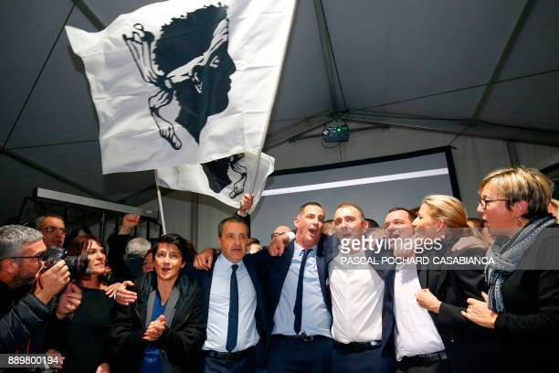 Candidates for the Pe a Corsica nationalist party Jean Guy Talamoni and Gilles Simeoni celebrate with party members and supporters after the...
