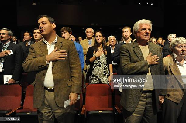 Candidates listen to the introduction at the beginning of the presidential debate sponsored by The Washington Post via Getty Images and Bloomberg at...