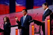 Candidates Michele Bachmann Mitt Romney and Rick Perry debate during Ronald Reagan Centennial GOP Presidential Primary Candidates Debate at the...
