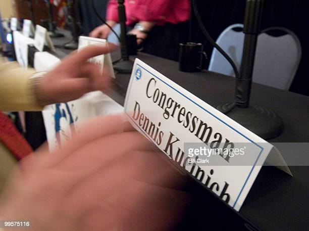 Candidates' name plates are set up on the stage at the Crowne Plaza Cleveland City Centre Hotel for the Ohio 10th District Congressional debate on...
